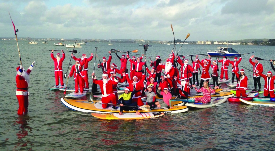 Christmas Santa SUP Poole Harbour Watersports