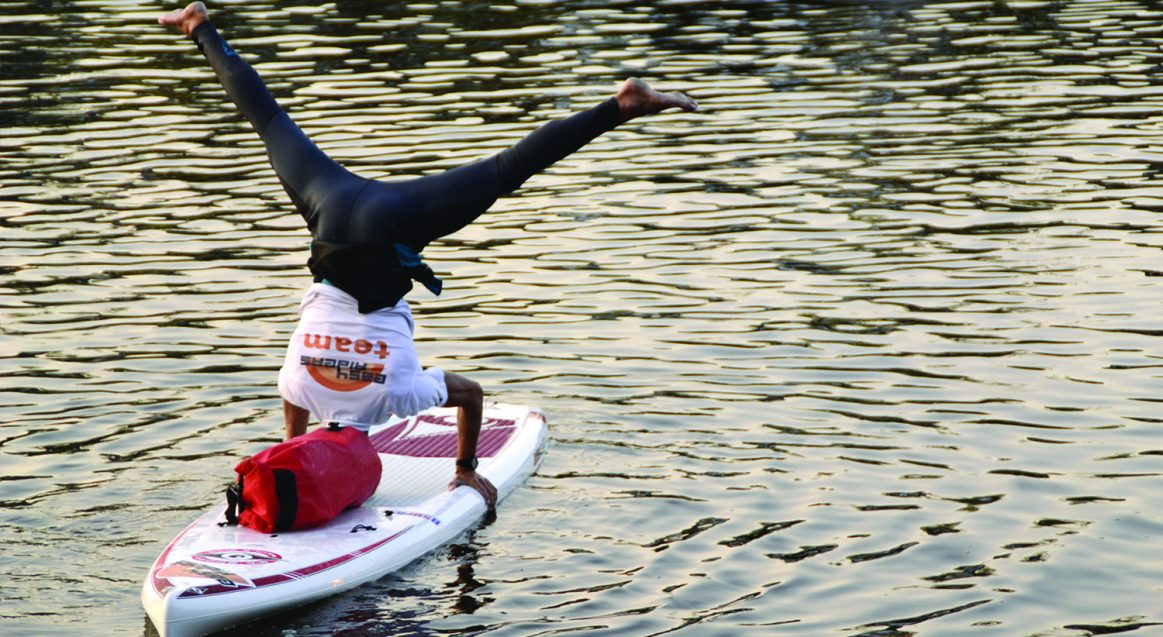 SUP Yoga Class Headstand Poole Harbour